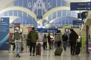 Travelers make their way Wednesday, Nov. 21, 2018 through San Antonio International Airport the day before Thanksgiving.