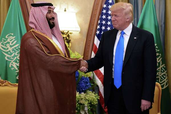 "(FILES) In this file photo taken on May 20, 2017 US President Donald Trump (R) and Saudi Deputy Crown Prince Mohammad bin Salman al-Saud take part in a bilateral meeting in Riyadh. - Trump on November 21, 2018, thanked Saudi Arabia for lower oil prices -- a day after pledging the US would remain a ""steadfast partner"" of the kingdom despite the murder of a prominent journalist. ""Oil prices getting lower. Great! Like a big Tax Cut for America and the World. Enjoy! $54, was just $82,"" he tweeted. ""Thank you to Saudi Arabia, but let's go lower!"" (Photo by MANDEL NGAN / AFP)MANDEL NGAN/AFP/Getty Images"