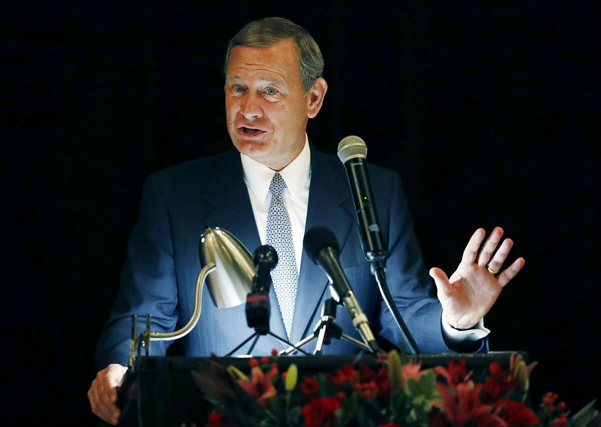 """FILE - In this Sept. 27, 2017 file photo, Chief Justice John Roberts speaks during the Bicentennial of Mississippi's Judiciary and Legal Profession Banquet in Jackson, Miss. Roberts is pushing back against President Donald Trump's description of a judge who ruled against the administration's new asylum policy as an """"Obama judge."""" It's the first time that the leader of the federal judiciary has offered even a hint of criticism of Trump, who has previously blasted federal judges who ruled against him. Roberts says Wednesday that the U.S. doesn't have """"Obama judges or Trump judges, Bush judges or Clinton judges."""" He is commenting in a statement released by the Supreme Court after a query by The Associated Press. (AP Photo/Rogelio V. Solis)"""