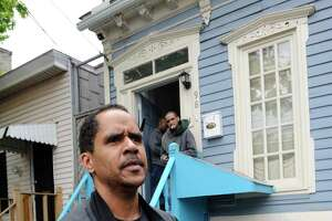 Miles Bailey stands in front of 98 Bradford Street where he is the landlord on May 7, 2009, in Albany, N.Y.,  where the alleged murder of Richard Hagin took place.