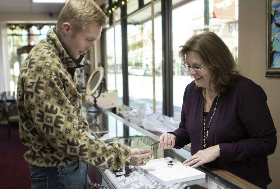 Brownlee Jewelers owner Janice Parish-Brownlee helps Brenham resident Wayne Beckermann select a diamond for an engagement ring Wednesday, Nov. 21, 2018 at Brownlee Jewelers in downtown Conroe. Photo: Cody Bahn, Houston Chronicle / Staff Photographer / © 2018 Houston Chronicle