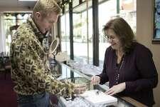 Brownlee Jewelers owner Janice Parish-Brownlee helps Brenham resident Wayne Beckermann select a diamond for an engagement ring Wednesday, Nov. 21, 2018 at Brownlee Jewelers in downtown Conroe.