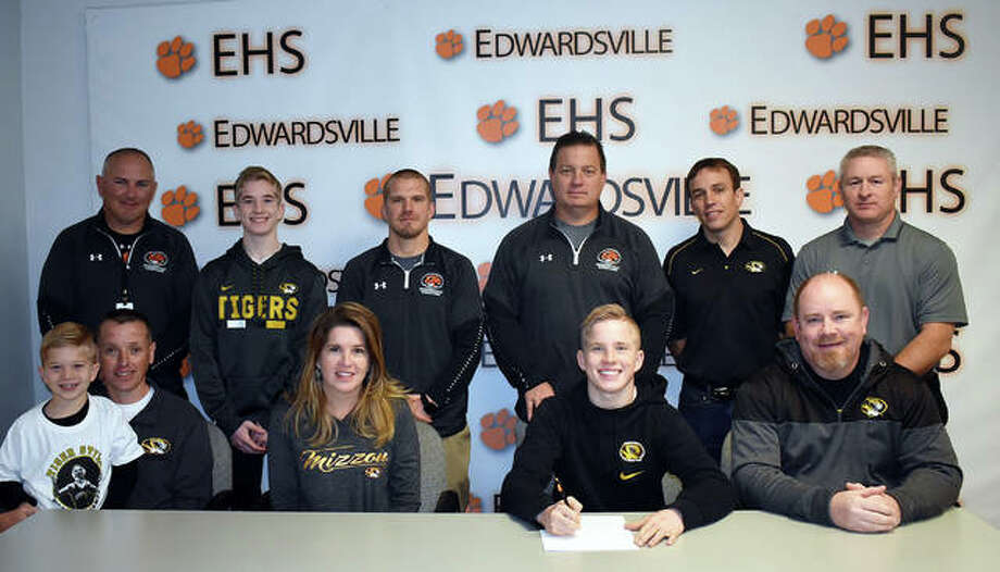 Edwardsville senior Noah Surtin will wrestle for Missouri in college. Pictured in no particular order are Noah Surtin, stepdad Mike Monroe, brother Connor Surtin, brother Sean Monroe, mother Kim Monroe, father John Surtin, assistant coaches Ryan Followell, Kevin Matarelli and Eric Pretto, club coach Pat Mcnamara and EHS coach Jon Wagner. Photo: Matt Kamp/Intelligencer
