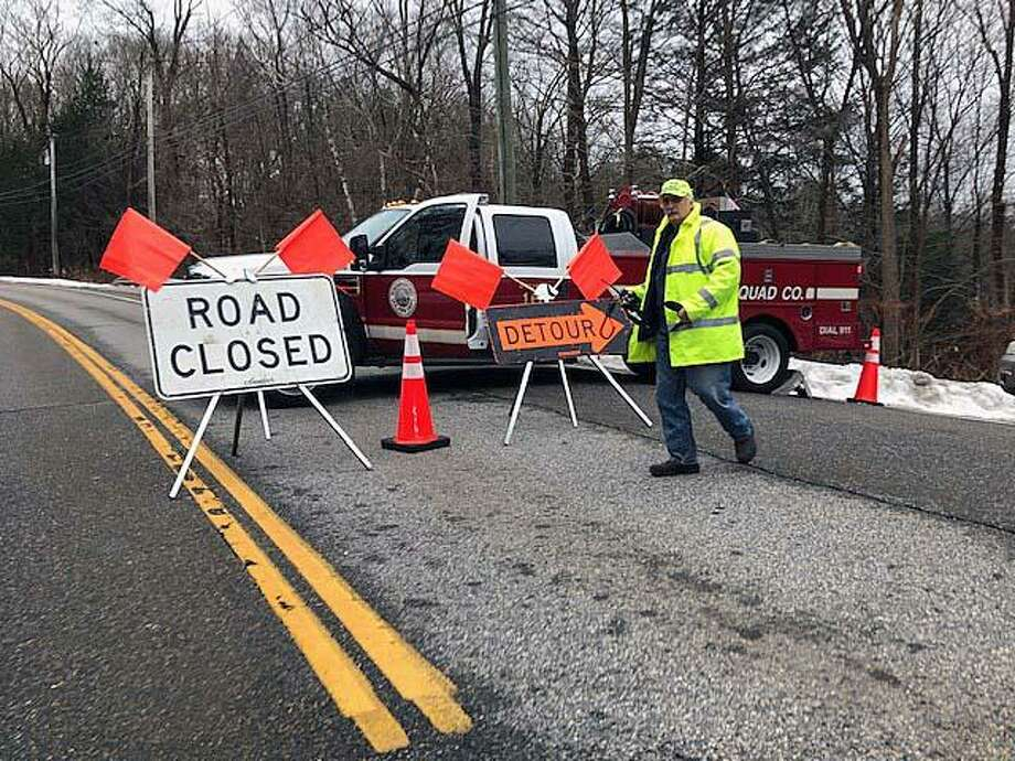 Members of the Torringford Volunteer Fire Department directed traffic onto a detour on Goshen Road - Route 4, about 12:30 on Tuesday following a hean-on crash. Photo: Leslie Hutchison / Hearst Connecticut Media / Connecticut Post