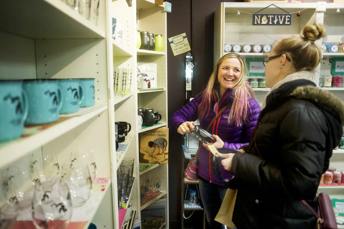 Midland native Harmony McCoy of Colorado, center, and Emily Rissman of Coldwater, right, shop at Coyer Candle Co. on Wednesday, Nov. 21, 2018 in Midland. (Katy Kildee/kkildee@mdn.net)