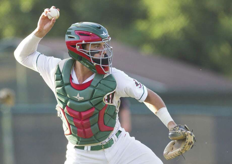 The Woodlands catcher Drew Romo (23) tries to out Ben Shields #20 of Montgomery who reached on an error by second baseman Ryan Solberg in the first inning of Game 1 during Class 6A Region II quarterfinal series on Thursday, May 17, 2018, in The Woodlands. Photo: Jason Fochtman, Staff Photographer / Houston Chronicle / © 2018 Houston Chronicle