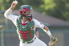 The Woodlands catcher Drew Romo (23) tries to out Ben Shields #20 of Montgomery who reached on an error by second baseman Ryan Solberg in the first inning of Game 1 during Class 6A Region II quarterfinal series on Thursday, May 17, 2018, in The Woodlands.