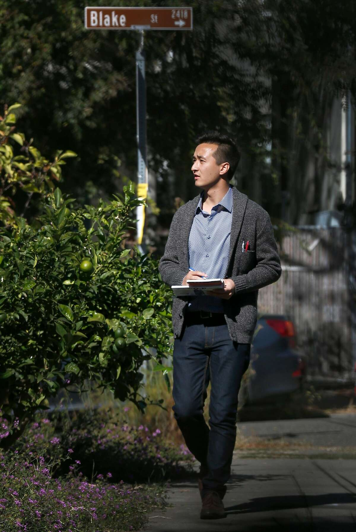 Rigel Robinson, a candidate running for the Berkeley City Council District 7 seat, canvasses a neighborhood in Berkeley, Calif. on Saturday, Oct. 27, 2018.