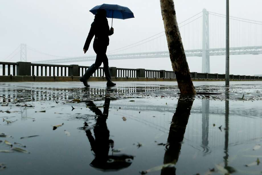 A woman walks along the Embarcadero on Wednesday, Nov. 21, 2018, in San Francisco, Calif. Photo: Santiago Mejia / The Chronicle