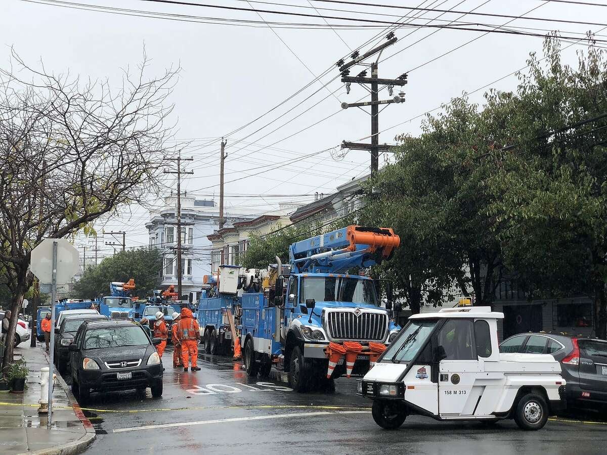 Pacific Gas & Electric Company workers at 23rd and Florida examine power poles after an outage left thousands of San Franciscans without power.
