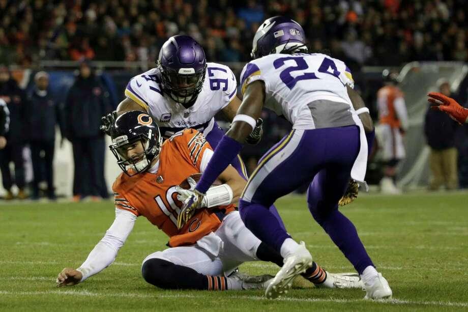 Chicago Bears quarterback Mitchell Trubisky (10) slides for yardage against  Minnesota Vikings defensive end 64c68d8ab