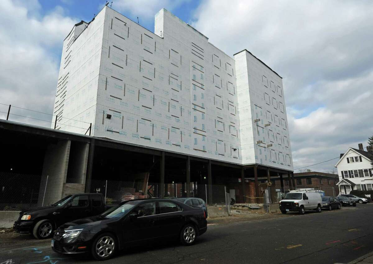 The stalled first phase of the development Wall Street Place in November 2018, at Isaacs Street in Norwalk, Conn. The Norwalk Chief Building Official Willam Ireland says Citibank has been fined, received a failure-to-pay notification and can request a public hearing for the blight violation it received from the city in September over the condition of the stalled first phase of Wall Street Place. Ireland's summary comes in response to an email inquiry from commercial real-estate broker Jason Milligan, who has asked for the city to crack down on what he calls the Tyvek Temple.