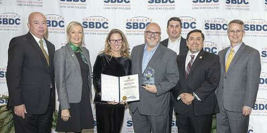 Petra Oil Company, Inc. receives the 2018 Minority-Owned Small Business of the Year Award, at the 32nd annual Small Business Awards Luncheon. Shown (left - right) are Dr. Stephen C. Head, Ph.D., LSC chancellor; Lisa Renko, Woodforest National Bank Community Development Relationship manager, Heather Washburn, U.S. Rep. Kevin Brady, district director; Arnold Gacita, Petra Oil Company, Inc. president; Josh Fowler Woodforest National Bank assistant vice president, South Montgomery County market manager; Miguel Lopez, LSC SBDC executive director; and Tim Jeffcoat, district director of the U.S. Small Business Administration Houston District Office.