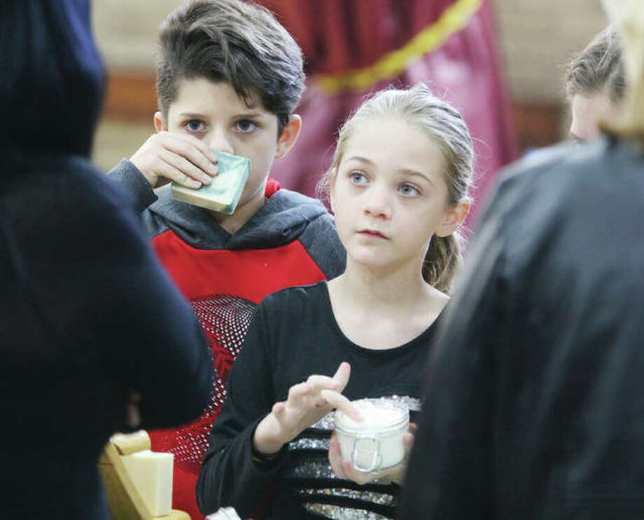 Two kids sample soaps and bath salts during last year's Green Gift Bazaar at Alton YWCA. According to the National Retail Federation, a retail trade group, an estimated 164 million people plan to go shopping from Gray Thursday through Cyber Monday this year. Photo: Scott Cousins | Hearst Illinois