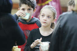 Two kids sample soaps and bath salts during last year's Green Gift Bazaar at Alton YWCA. According to the National Retail Federation, a retail trade group, an estimated 164 million people plan to go shopping from Gray Thursday through Cyber Monday this year.