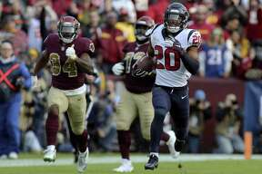 Houston Texans strong safety Justin Reid (20) returns an interception for a touchdown against the Washington Redskins in an NFL game, Sunday, November 18, 2018 in Landover, Md. (AP Photo/Daniel Kucin Jr.)