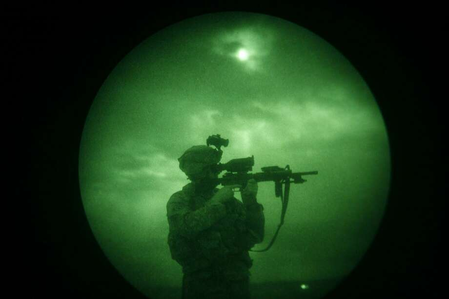 Character and illness are two separate things. Post-traumatic stress disorder can and does happen to courageous and strong members of the military. Here,a U.S soldier looks through the scope of his weapon in 2008 during a night patrol in Afghanistan. Photo: Associated Press File Photo / AP2008