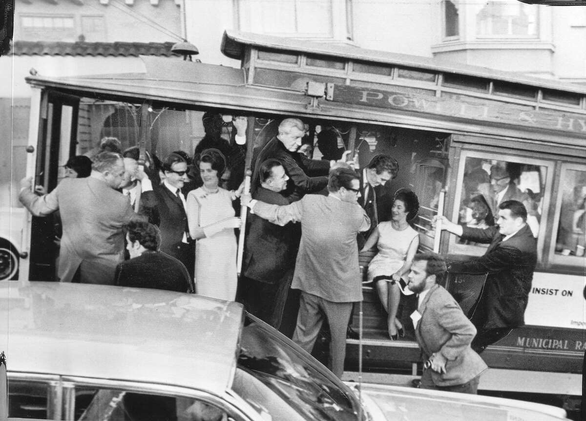 Her security goup relented and Princess Margaret was able to ride on a cable car. Everyone is holding on tight as the car begins it's ascent of Hyde Street , November 5, 1965 Associated Press photo ran 11/6/1965., p. 8