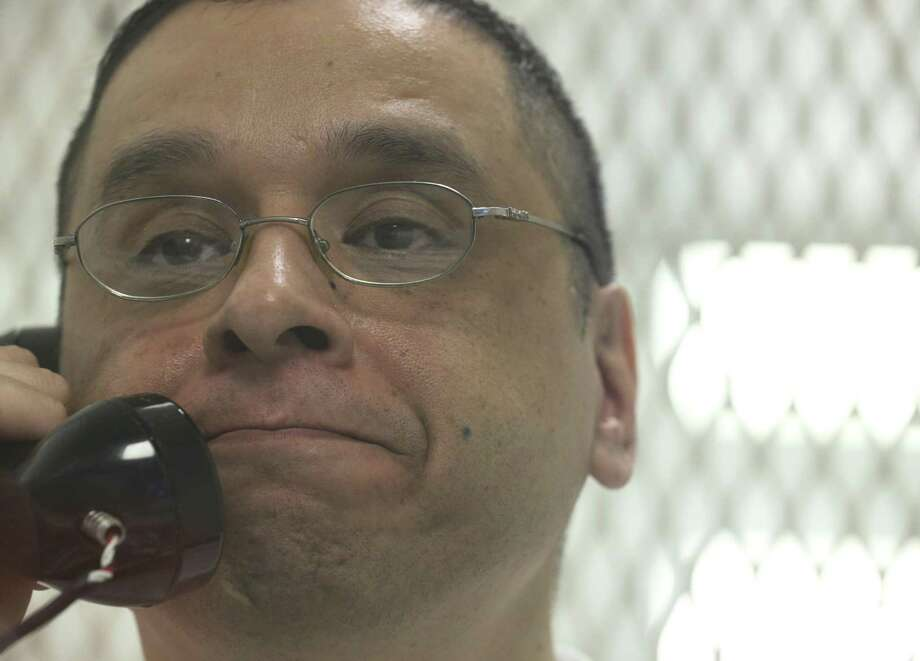 "Death row inmate Joseph Garcia gets emotional during an interview at Polunsksy Unit on Wednesday, Oct. 31, 2018, in Livingston. ""I don't think there's enough words in the world to say to him what he needs to hear,"" he said of the son of Officer Aubrey Hawkins, who was gunned down on Christmas Eve in 2000 during a robbery at an Irving sporting goods store. Photo: Yi-Chin Lee, Houston Chronicle / Staff Photographer / © 2018 Houston Chronicle"
