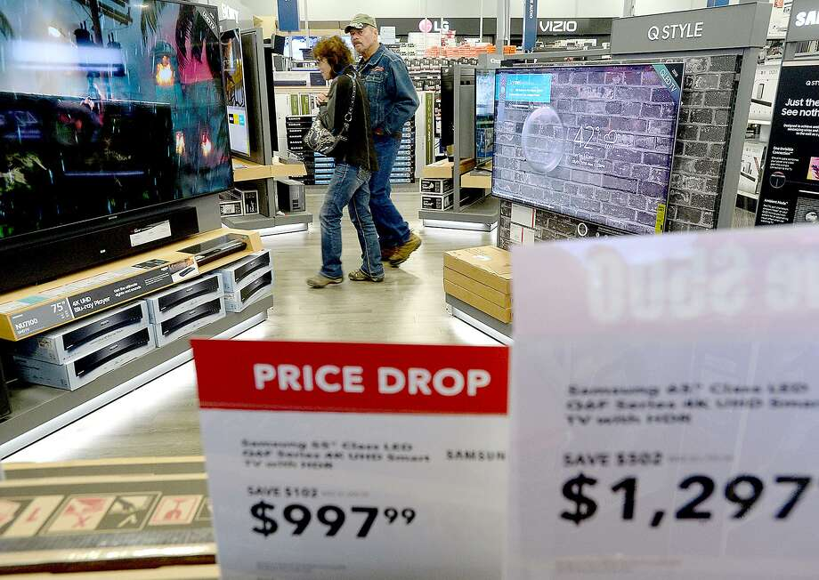 Shoppers make their way through Best Buy, where stacks and displays of sale items fill the store in preparation for Thanksgiving and Black Friday shoppers.  Photo taken Wednesday, November 21, 2018  Kim Brent/The Enterprise Photo: Kim Brent / The Enterprise / BEN