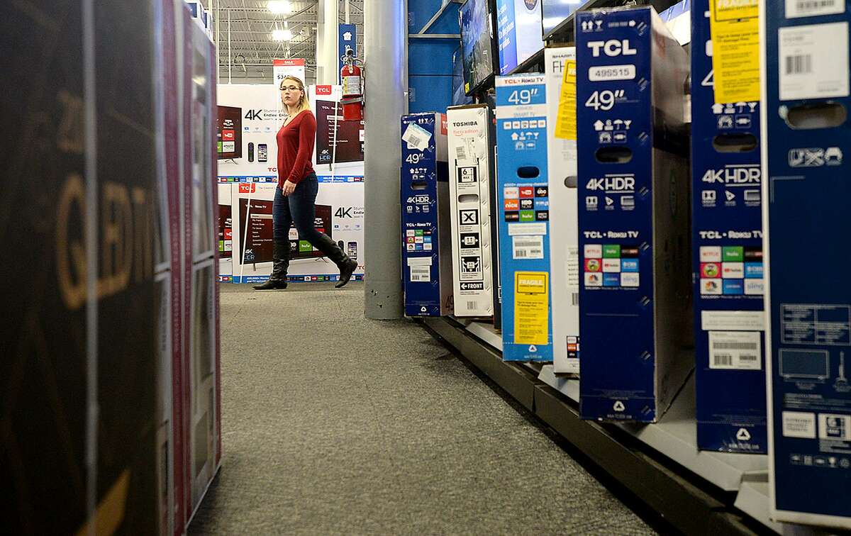 Shoppers make their way through Best Buy, where stacks and displays of sale items fill the store in preparation for Thanksgiving and Black Friday shoppers. Photo taken Wednesday, November 21, 2018 Kim Brent/The Enterprise