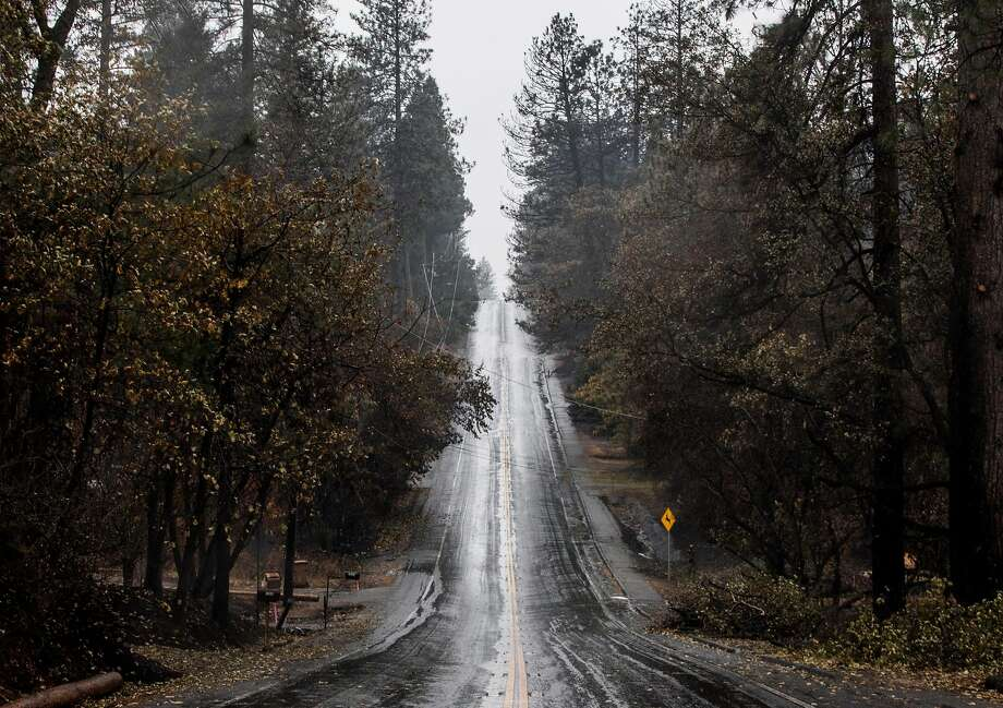 FILE -- Rain falls onto Billie Road in Paradise, Calif. Wednesday, Nov. 21, 2018 as crews work to clear debris and other hazards after the Camp Fire destroyed most of the town. Butte County is under a flood watch Wednesday afternoon to Thursday morning, which includes areas affected by the Camp Fire. Photo: Jessica Christian / The Chronicle