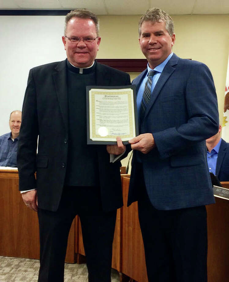 """Edwardsville Mayor Hal Patton, right, presented Pastor Fr. Jeff Goeckner with a proclamation commemorating the 150th Anniversary of St. Boniface Catholic Church at a city council meeting Tuesday. Patton proclaimed the year 2019 as St. Boniface Catholic Church """"Year of Jubilee"""" in the community. Photo: Cindy Zurliene Of St. Boniface Church 