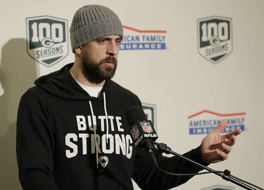 "Green Bay Packers quarterback Aaron Rodgers wears a sweatshirt that reads ""Butte Strong"" after last week's game. Photo: Stephen Brashear / Associated Press"