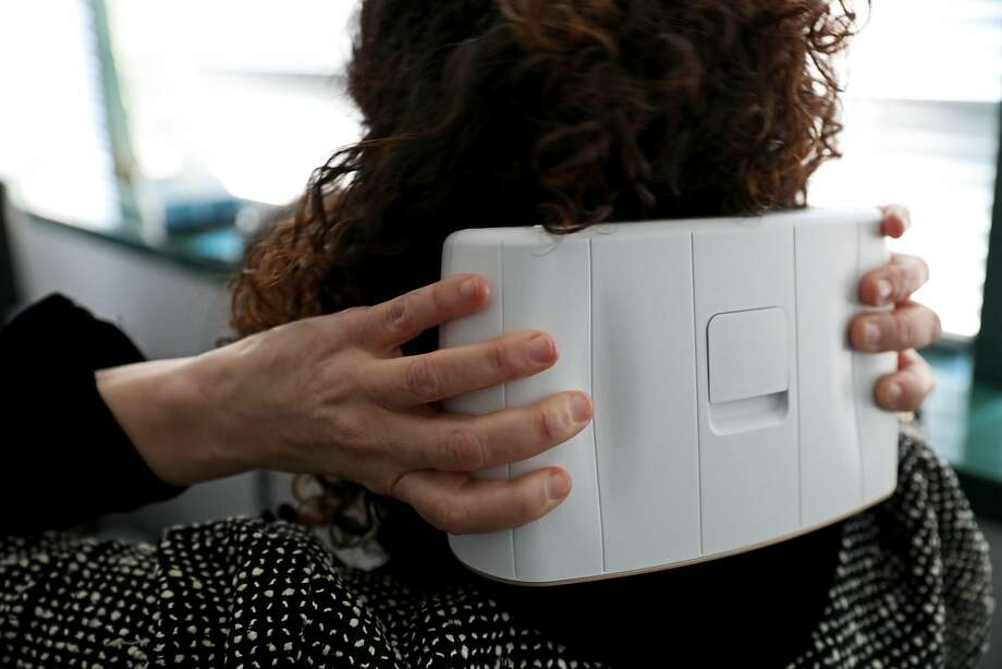 Rebecca Brook holds a sTMS mini by eNeura during her appointment with Dr. Nina Riggins, a neurologist at the UCSF Headache Center. She has also been trying a new FDA-approved drug with some success. Photo: Yalonda M. James / The Chronicle