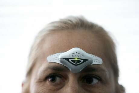 """Cessa Marshall wears a Cefaly device on her forehead during an appointment with Dr. Nina Riggins, neurologist, University of California San Francisco (UCSF) Headache Center, in San Francisco, Calif., on Thursday, November 8, 2018. According to the product's brochure, Cefaly is a """"FDA approved External Trigeminal Nerve Stimulation device for migraine treatment."""""""