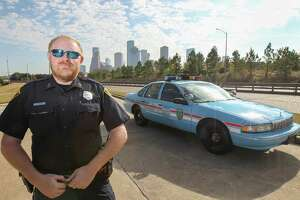 Houston Police Officer Jason Knox restored an old 1996 Chevrolet Caprice HPD cruiser and will drive it in the Thanksgiving Day parade Wednesday, Nov. 21, 2018, in Houston.