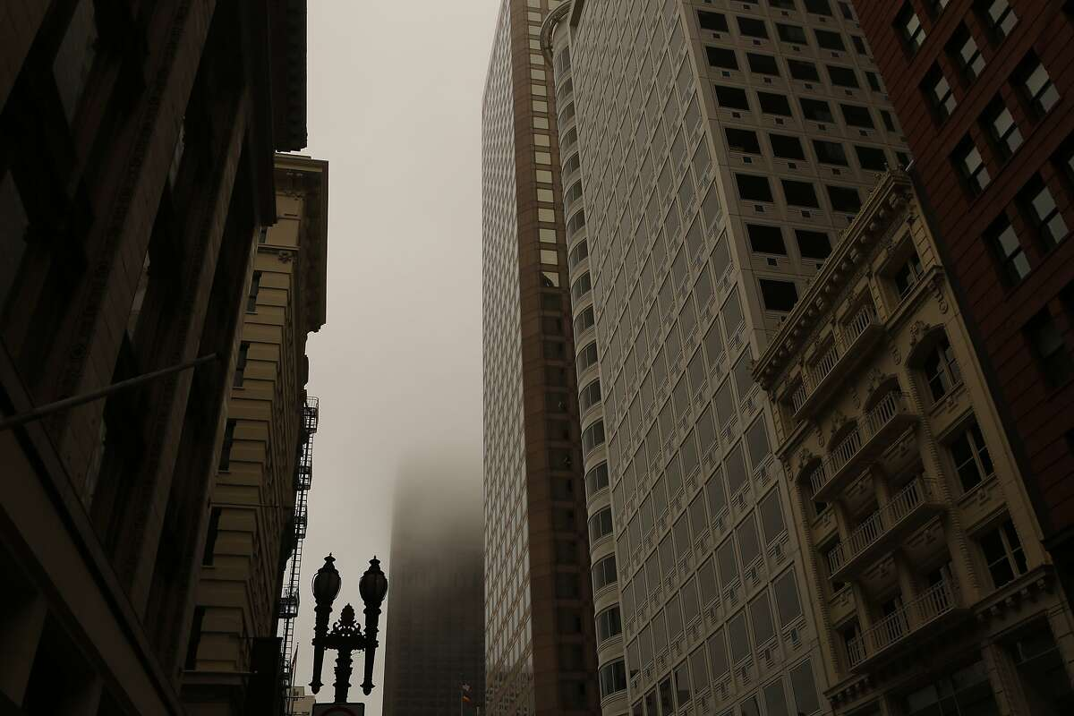 The 555 California Street Building is consumed in haze on Sunday, July 1, 2018 in San Francisco, Calif. Air quality in and around San Francisco has been visibly affected by the fires through the weekend.