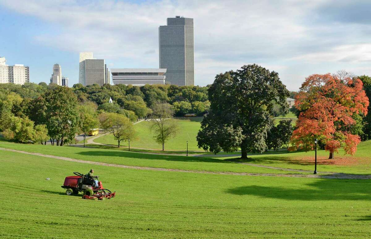 City DGS worker Christopher Palmatier mows the lawns at Lincoln Park on just a lovely Autumn morning Wednesday Oct. 17, 2018 in Albany, NY. (John Carl D'Annibale/Times Union)