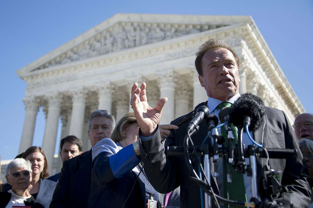Former California Governor Arnold Schwarzenegger speaks outside the US Supreme Court in Washington, DC, October 3, 2017, after the court heard arguments against gerrymandering. / AFP PHOTO / JIM WATSON (Photo credit should read JIM WATSON/AFP/Getty Images)
