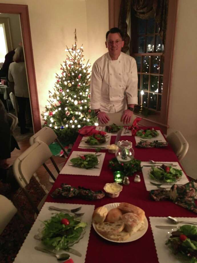The Clinton Historical Society's holiday luncheons and dinners are a tradition for many during the Christmas season. Above Chef Eric Ambler is ready to serve his guests at Old Brick. Photo: Contributed Photo