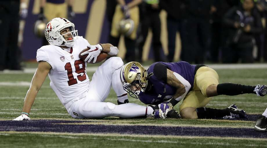 Stanford's JJ Arcega-Whiteside (19) is tackled by Washington's Byron Murphy after a pass reception during the first half of an NCAA college football game Saturday, Nov. 3, 2018, in Seattle. Arecga-Whiteside left the game with an injury. (AP Photo/Elaine Thompson) Photo: Elaine Thompson / Associated Press