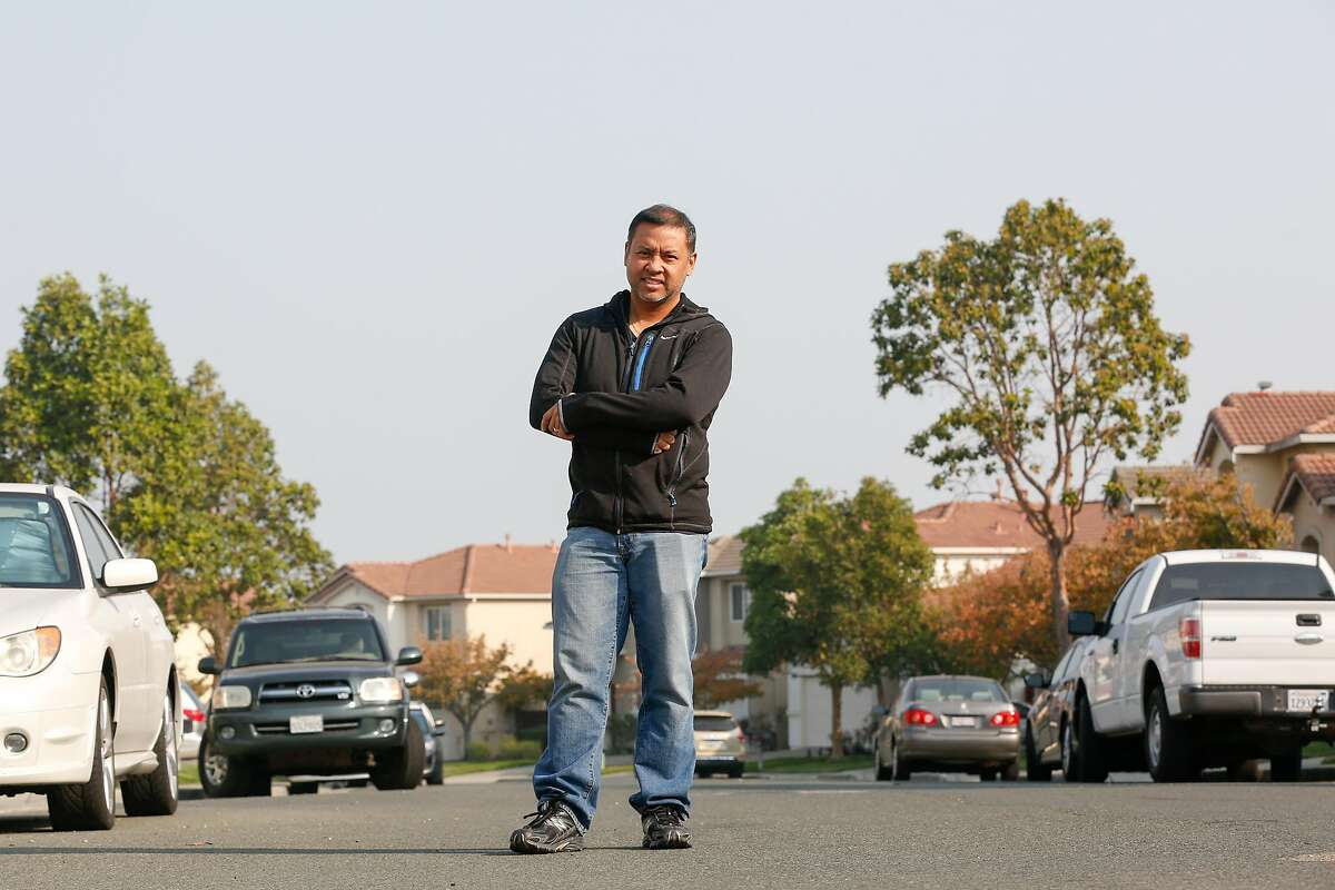 Country Club Vista Homeowners Association security committee chair, Joseph Navarez, stands for a portrait in the neighborhood that he moniters on Monday, November 12, 2018 in Richmond, Calif.
