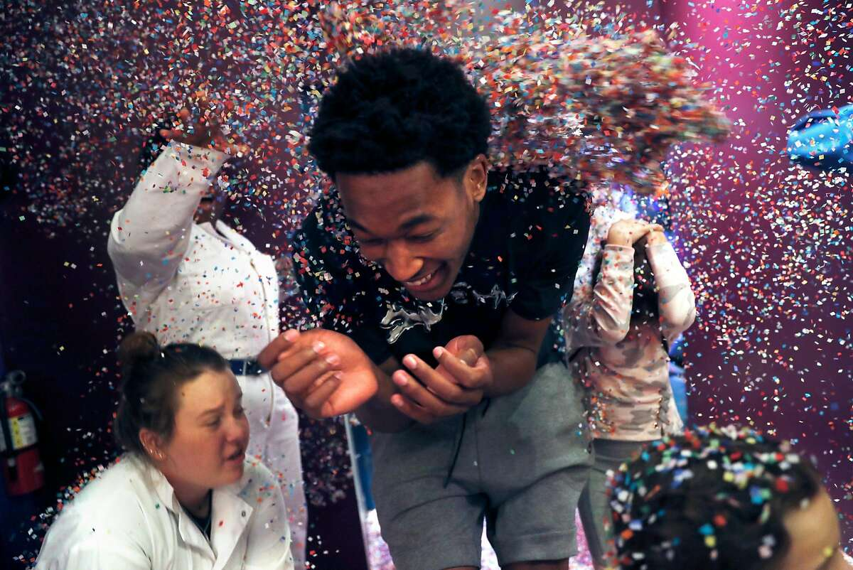 Golden State Warriors' Damian Jones gets doused with confetti at pop-up museum, Candytopia, on National Candy Day in San Francisco, Calif.. on Sunday, November 4, 2018.