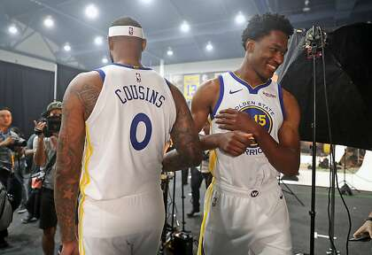 5b5e1fd844a4 Damian Jones and DeMarcus Cousins during Golden State Warriors  Media Day  in Oakland