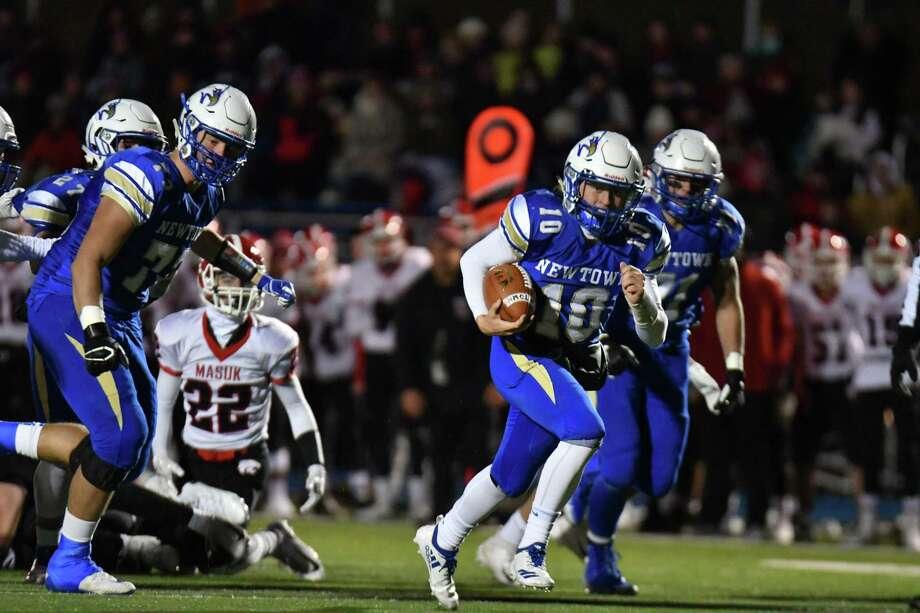 Newtown quarterback Luke Melillo runs for a first-quarter touchdown against Masuk on Wednesday. Photo: Gregory Vasil / For Hearst Connecticut Media / Connecticut Post Freelance