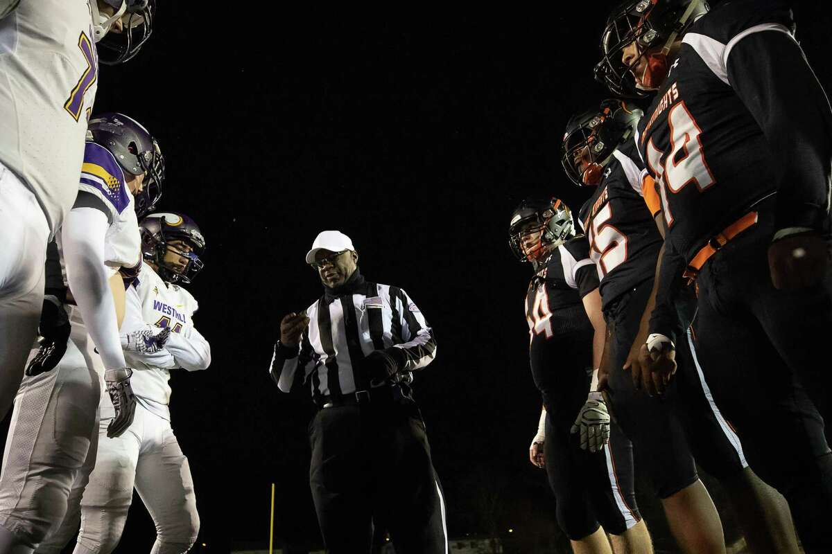 Captains from both Stamford and Westhill stand by for the coin toss just prior to a Varsity High School Football game between the Stamford Black Knights and the Westhill Vikings, on November 21, 2018 at Boyle Stadium in Stamford, CT.