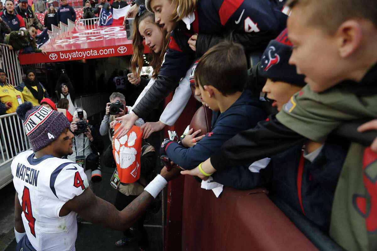Quarterback Deshaun Watson (4) high-fives fans after guiding the Texans to a 23-21 victory at Washington last Sunday. With their seventh straight win, the Texans tied a franchise record.