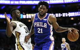 Philadelphia 76ers center Joel Embiid (21) moves around New Orleans Pelicans forward Julius Randle (30) during the second half on an NBA basketball game, Wednesday, Nov. 21, 2018, in Philadelphia. The 76ers won 121-120. (AP Photo/Laurence Kesterson)