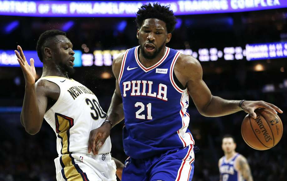 Philadelphia 76ers center Joel Embiid (21) moves around New Orleans Pelicans forward Julius Randle (30) during the second half on an NBA basketball game, Wednesday, Nov. 21, 2018, in Philadelphia. The 76ers won 121-120. (AP Photo/Laurence Kesterson) Photo: Laurence Kesterson, Associated Press
