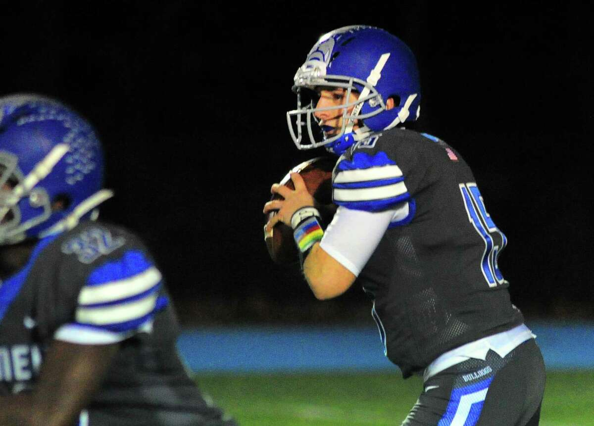 Bunnell QB Brian Carrafiello prepares to throw a pass to Eli Alexandre for a touchdown during Thanksgiving holiday football action against Stratford in Stratford, Conn., on Wednesday Nov. 21, 2018.