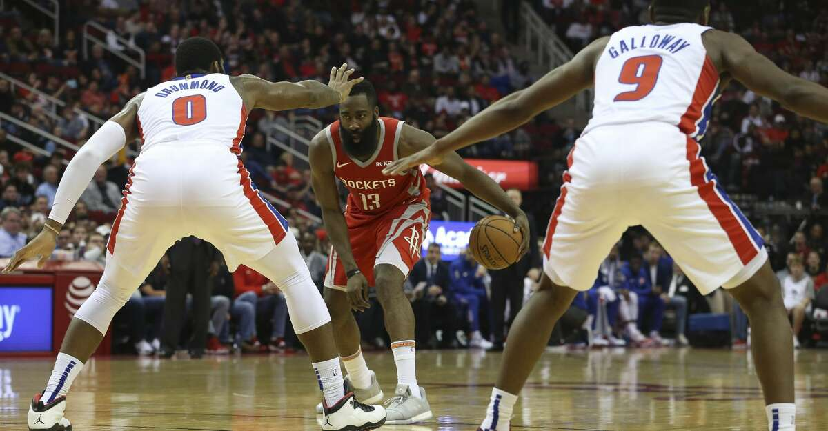 Houston Rockets center Clint Capela (15) dribbles when Detroit Pistons players Andre Drummond (0) and Langston Galloway (9) is defensing during the second quarter of the NBA game at Toyota Center on Wednesday, Nov. 21, 2018, in Houston.