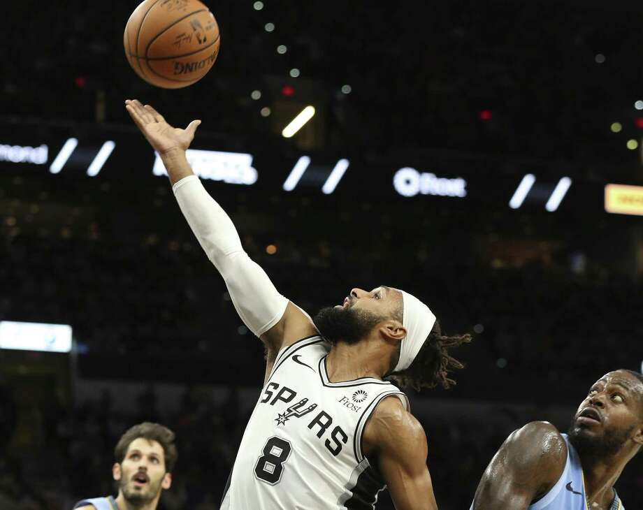 Spurs' Patty Mills (08) gets fouled as he attempts a shot by Memphis Grizzlies' JaMychal Green (00) during their game at the AT&T Center on Wednesday, Nov. 21, 2018. (Kin Man Hui/San Antonio Express-News) Photo: Kin Man Hui, Staff Photographer / San Antonio Express-News / ©2018 San Antonio Express-News