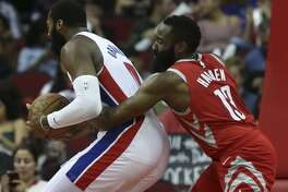 Houston Rockets guard James Harden (13) tries to strip the ball from Detroit Pistons center Andre Drummond (0) during the first quarter of the NBA game at Toyota Center on Wednesday, Nov. 21, 2018, in Houston.