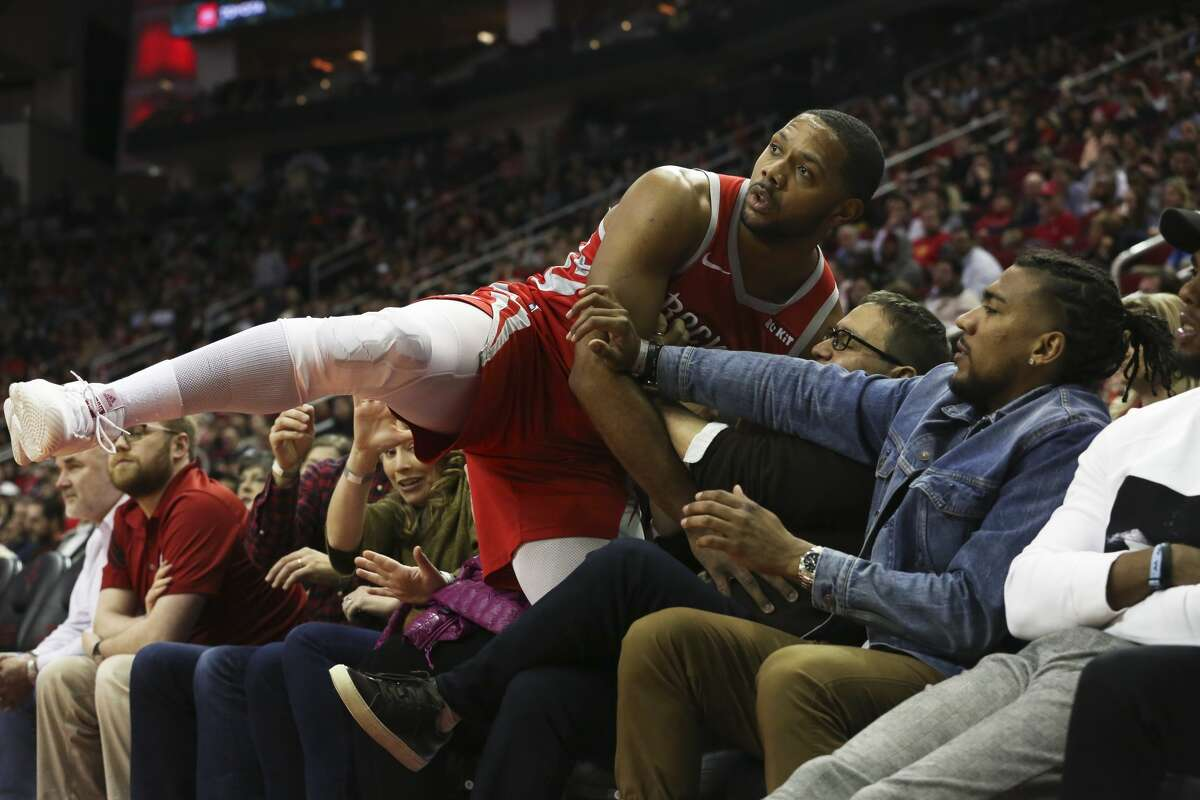 Houston Rockets guard Eric Gordon (10) falls onto the courtside fans while trying to grab a loose ball during the fourth quarter of the NBA game against the Detroit Pistons at Toyota Center on Wednesday, Nov. 21, 2018, in Houston. The Houston Rockets defeated the Detroit Pistons 126-124.