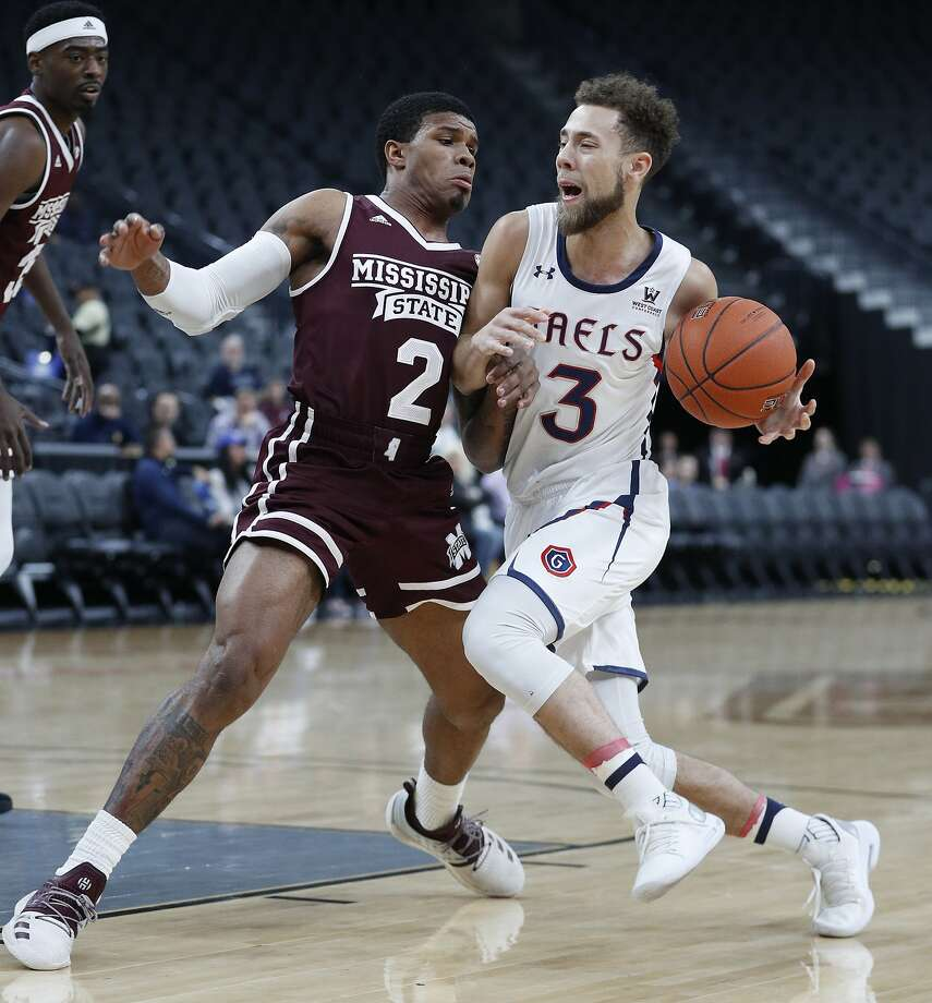 Saint Mary's Jordan Ford (3) drives into Mississippi State's Lamar Peters during the first half of an NCAA college basketball game Wednesday, Nov. 21, 2018, in Las Vegas. (AP Photo/John Locher) Photo: John Locher / Associated Press